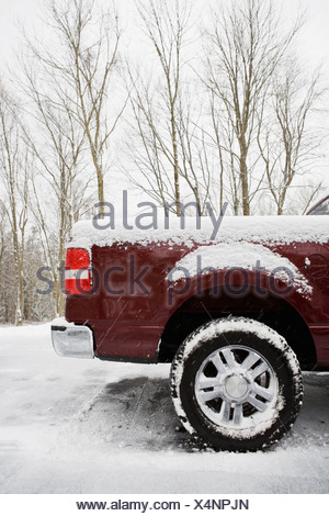 Rear of pickup truck covered in snow - Stock Photo