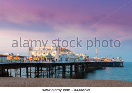 geography / travel, Great Britain, England, East Sussex, Brighton, Brighton pier and beach, Palace pier, built in 1899, shoreline at dusk, sunset, Additional-Rights-Clearance-Info-Not-Available - Stock Photo
