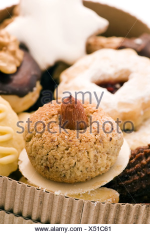 Christmas cookie collection as closeup in a cardboard - Stock Photo