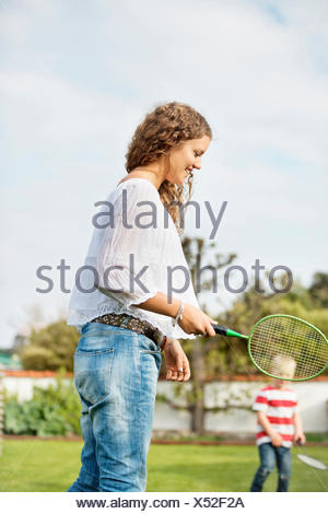 Woman playing badminton with son - Stock Photo