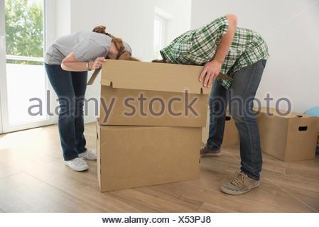 Man woman looking searching inside box - Stock Photo