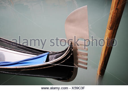 Ferro with metal teeth, metal design on the bow of a gondola, Venice, Venezia, Veneto, Italy, Europe - Stock Photo