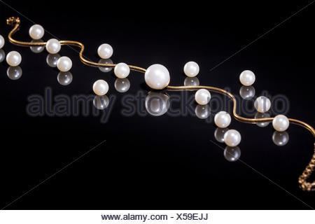 White pearls necklace on black background - Stock Photo