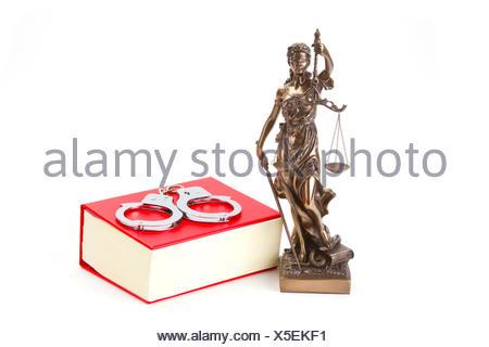 Justizia mit Gesetzbuch freigestellt auf weissem Hintergrund - Stock Photo