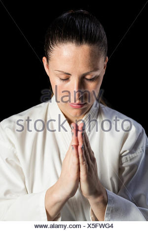 Close-up of female karate fighter meditating - Stock Photo