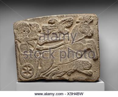 Orthostat relief: lion-hunt scene. Period: Neo-Hittite; Date: ca. 9th century B.C; Geography: Syria, Tell Halaf (ancient Guzana); Culture: Hittite; - Stock Photo