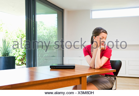 Sad business woman deep in thought - Stock Photo