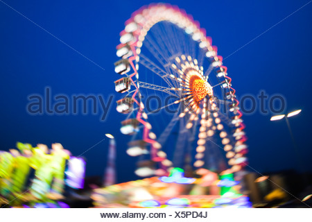 Ferris wheel lit up against night sky - Stock Photo
