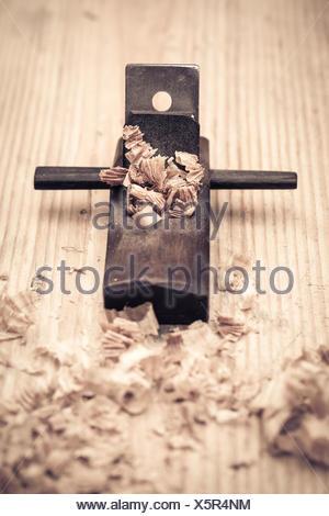 wood planer and shavings closeup - Stock Photo