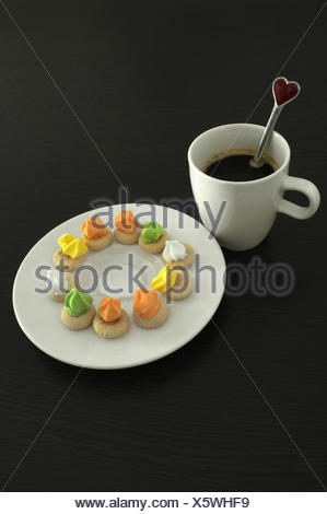 Hot coffee and thai traditional cookies on wooden background - Stock Photo