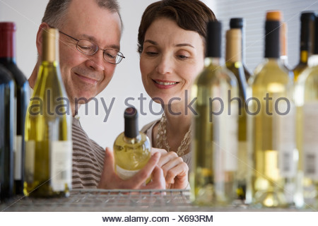 Couple looking at wine in store - Stock Photo