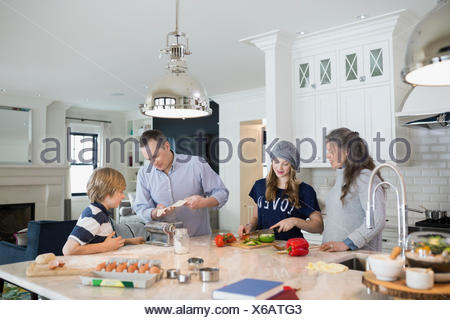 Family cooking in kitchen - Stock Photo