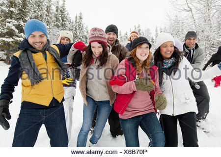 group of adults enjoying the wintery outdoors - Stock Photo