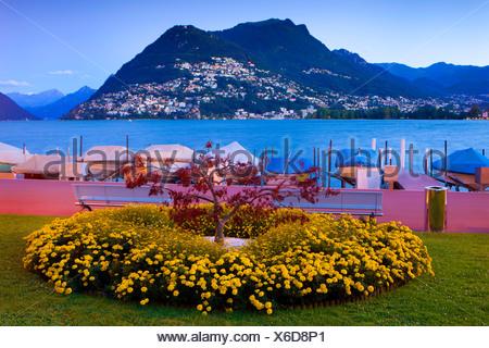 Paradiso, Switzerland, Europe, canton, Ticino, lake, Lago di Lugano, Lake of Lugano, dusk, boats, park - Stock Photo