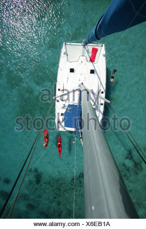 Kayak, snorkeler and open kayak viewed from the masthead of Moorings charter catamaran 'Pitch Pin', British Virgin Islands - Stock Photo