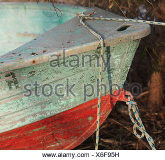 front end of old red and green boat tied up - Stock Photo