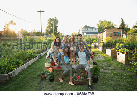 Portrait smiling friends in community garden - Stock Photo