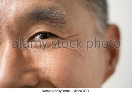 Close up of eyes of smiling man - Stock Photo