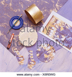 Close-up of materials for applying decoupage to a plywood box - Stock Photo