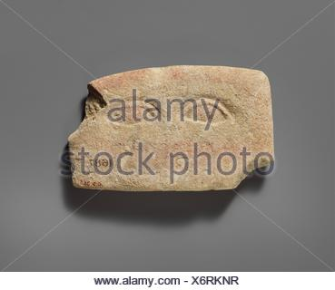 Limestone plaque with two eyes. Period: Classical; Date: 480-310 B.C; Culture: Cypriot; Medium: Limestone; Dimensions: Overall: 2 15/16 x 4 13/16 x - Stock Photo