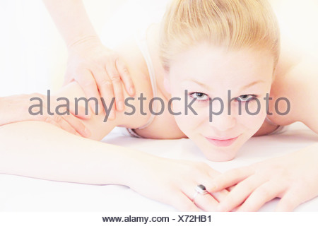 Woman having shoulder massage in spa - Stock Photo