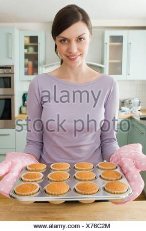 Woman baking cakes - Stock Photo