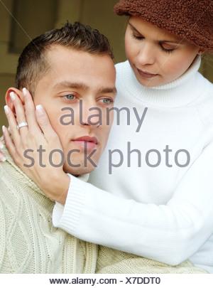 Junges Paar mit Rollkragenpullovern - Stock Photo