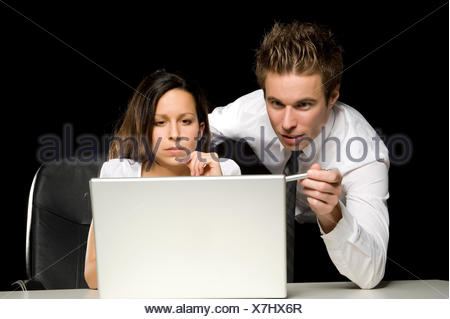 Two business people with laptop - Stock Photo