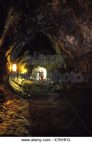 People exploring the interior of the Thurston lava tube at the Hawaii national volcano park - Stock Photo