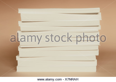 A stack of recycled white paper, paper supplies. - Stock Photo