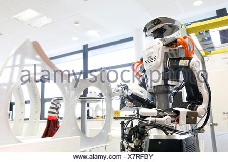 Robot with two arms for flexible robotics. Humanoid robot for automotive assembly tasks in collaboration with people, Industry, Tecnalia Research & - Stock Photo