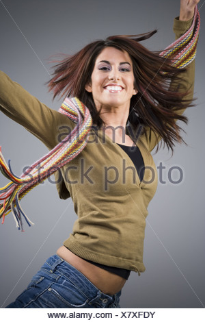 Casually dressed woman leaping - Stock Photo