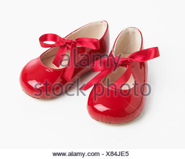 Red patent ribbon tie shoes - Stock Photo