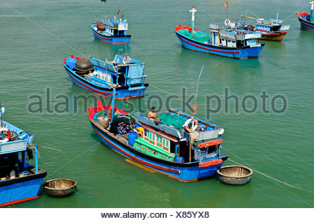 Fishing boats in the harbor of Nha Trang on the Cai river, Vietnam, Southeast Asia - Stock Photo