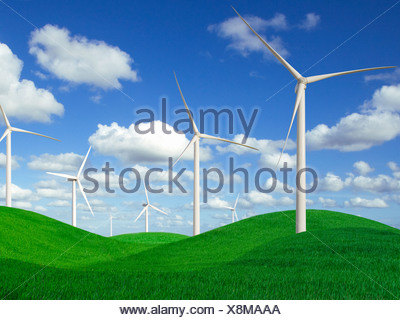 Wind turbines in rolling landscape of green grass - Stock Photo