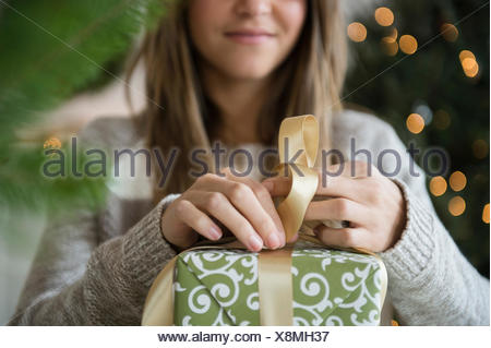 Woman preparing christmas gifts - Stock Photo