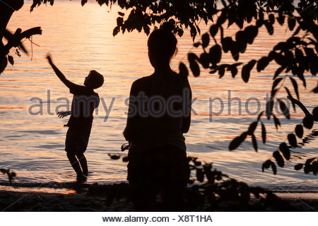 Berlin, Germany, a mother and her son on the Havel River at sunset - Stock Photo