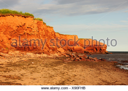 Red sandstone cliffs, typical coastline in Prince Edward Island National Park, Prince Edward Island, Canada - Stock Photo