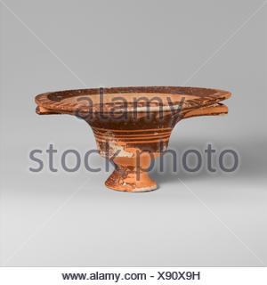 Terracotta stemmed dish with two handles. Period: Cypro-Geometric I; Date: 1050-950 B.C; Culture: Cypriot; Medium: Terracotta; Dimensions: H. 2 9/16 - Stock Photo