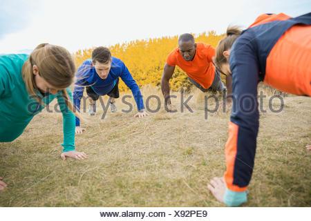 Group doing push-ups - Stock Photo