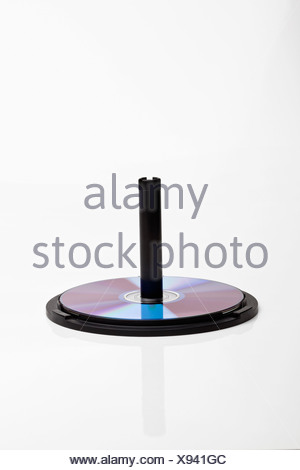 CDs on a CD spindle - Stock Photo