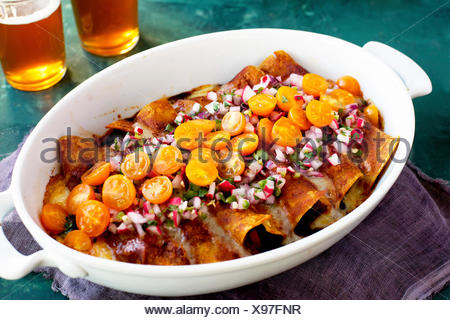 Black Bean Vegetable Enchiladas with home made enchilada sauce. - Stock Photo