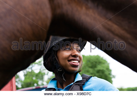 Close up of young woman with horse - Stock Photo