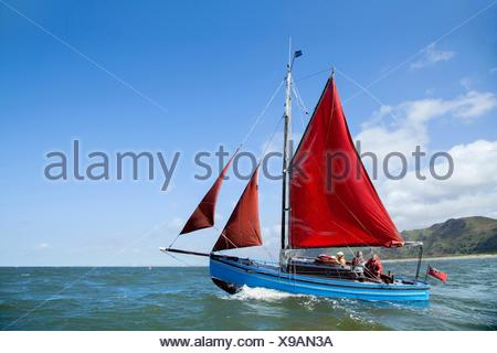 Small group of adults on sailing boat - Stock Photo