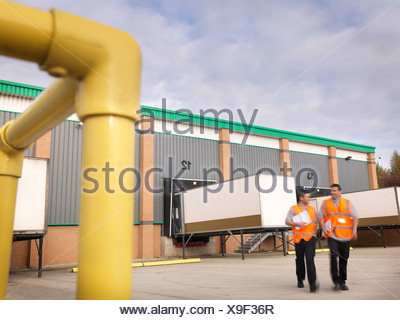 Workers with truck containers - Stock Photo