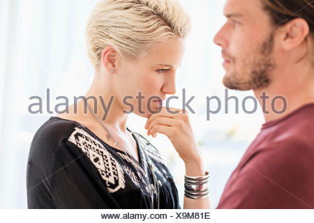 Couple arguing in living room - Stock Photo