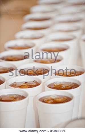 USA, Texas, Close up of styrofoam cups filled with iced tea - Stock Photo