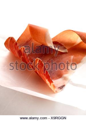 Slices of raw ham - Stock Photo