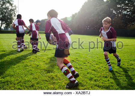 Teenage schoolboy rugby team in practice - Stock Photo