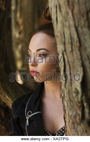 A young woman wearing makeup in a leather jacket  Pennsylvania USA - Stock Photo